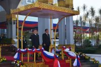 President Choummaly left accompanies King Norodom to inspect Guard of Honour of the Lao PDR - Copy